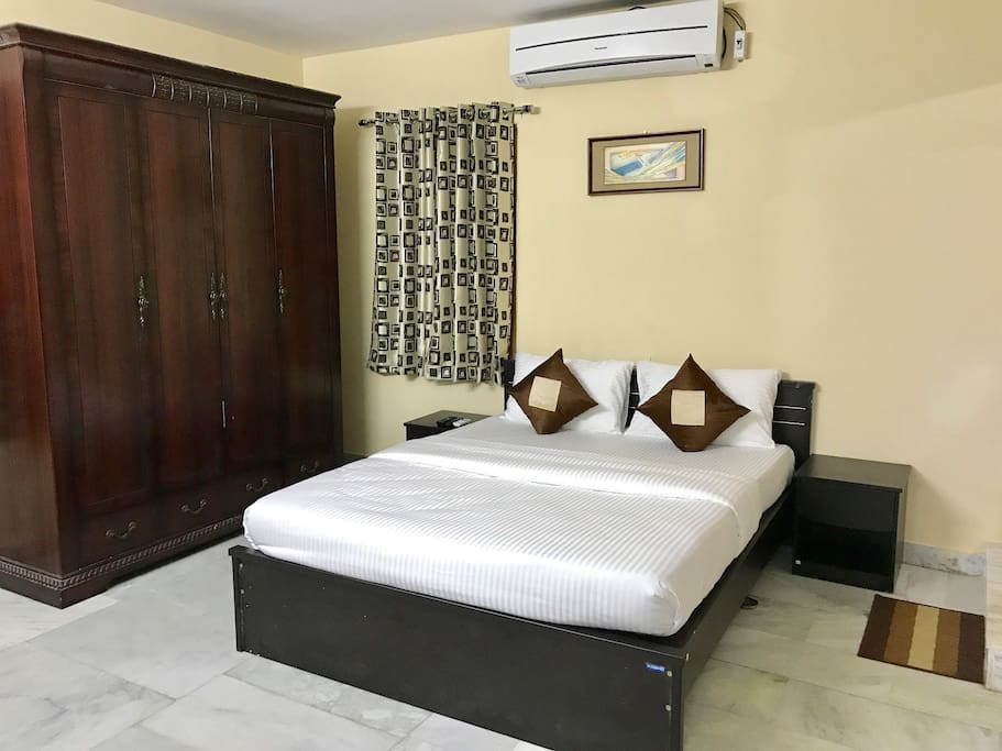 Bedroom with Queen Bed, large wardrobe and noiseless Split AC