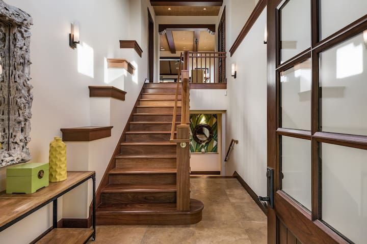 The elegant foyer and staircase greets you upon your entrance. Great room and kitchen are upstairs, bedrooms are downstairs.