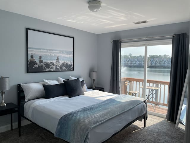 Master bedroom has a balcony with a bistro table and chairs for your morning coffee.