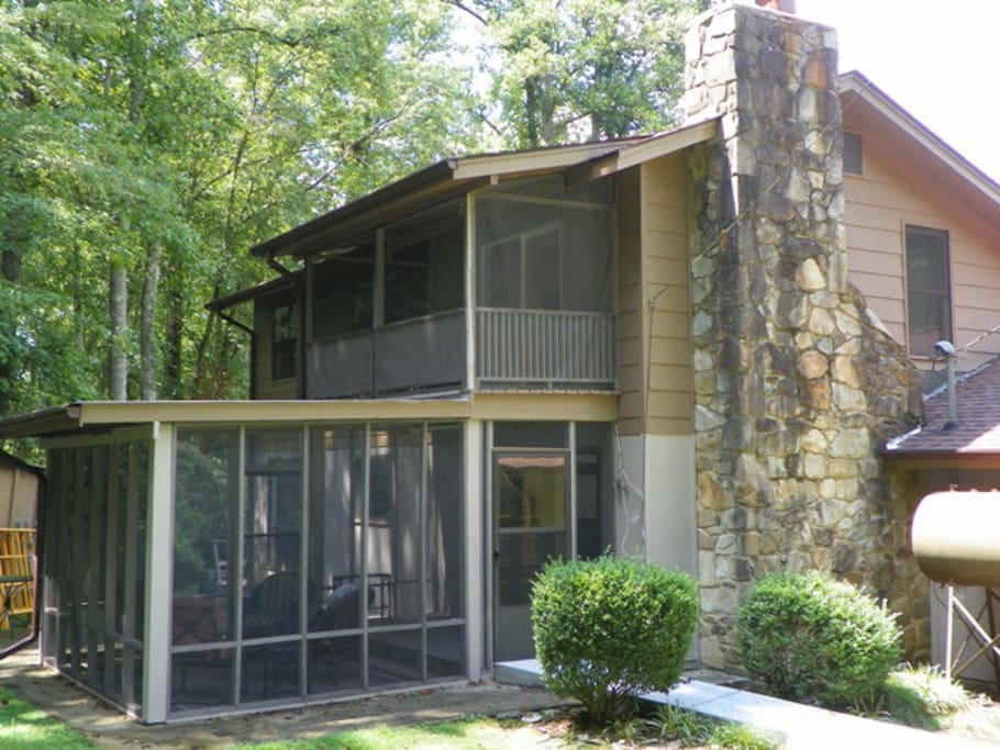 Private back yard with 2 screened porches
