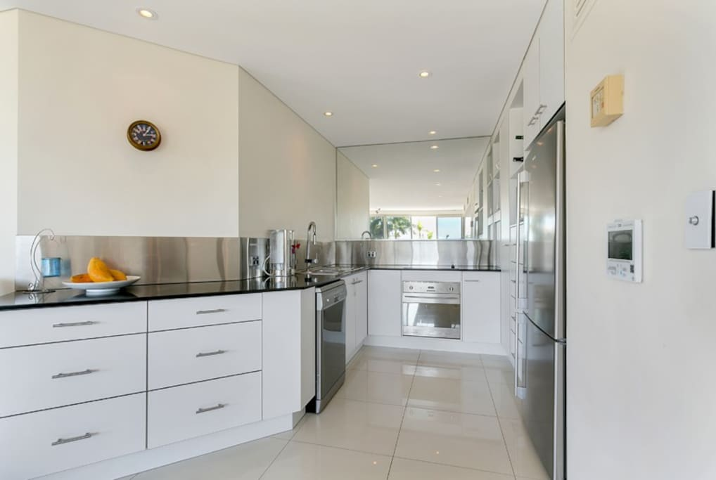 Fully equipped kitchen with oven, full size fridge, stove, dishwasher and all cutlery/crockery required to cook a delicious meal.