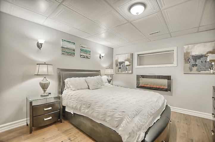 Specious Basement Bedroom with large window & Electric Fireplace