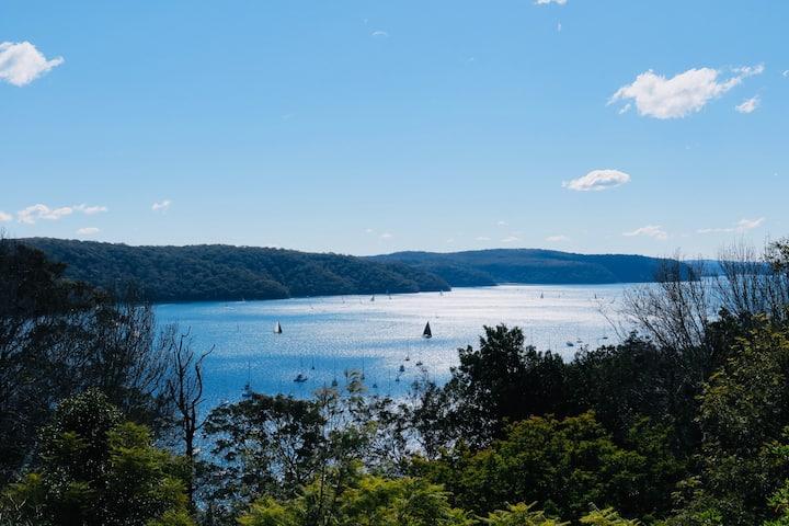 Panoramic Water Views in Treetop Luxury