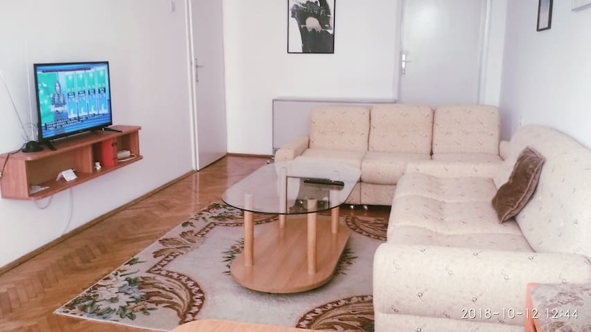 Apartment in front of a shopping center City Mall