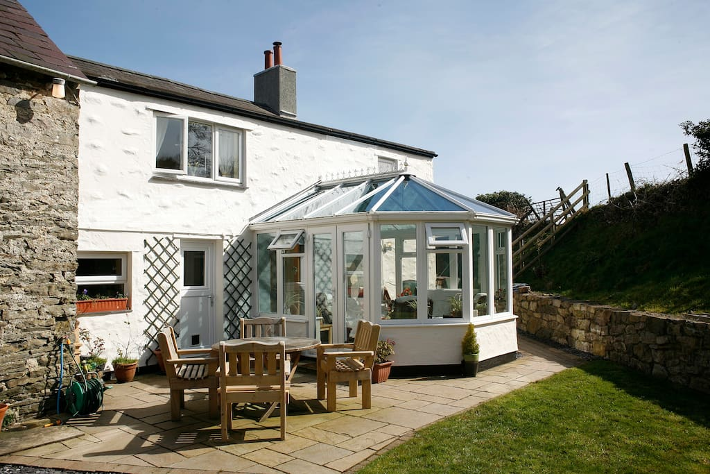 Enjoy sitting outside or play games in the large back garden.
