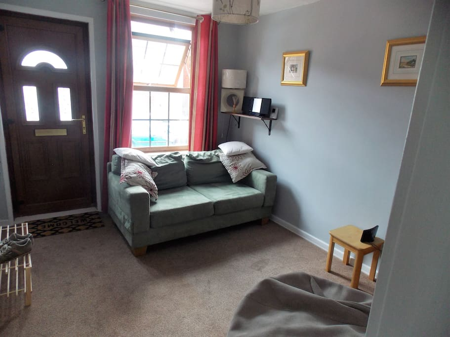 Cosy Lounge with TV, DVD, CD, DAB Radio, Games and Sofa that converts to a single bed if required.