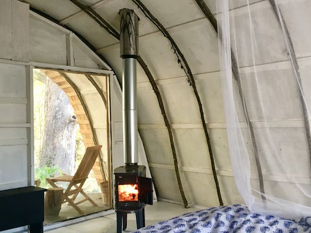 """""""Oh the weather outside is frightful, but the fire is so delightful...."""" - view from bed of our gorgeous Scandinavian wood stove."""