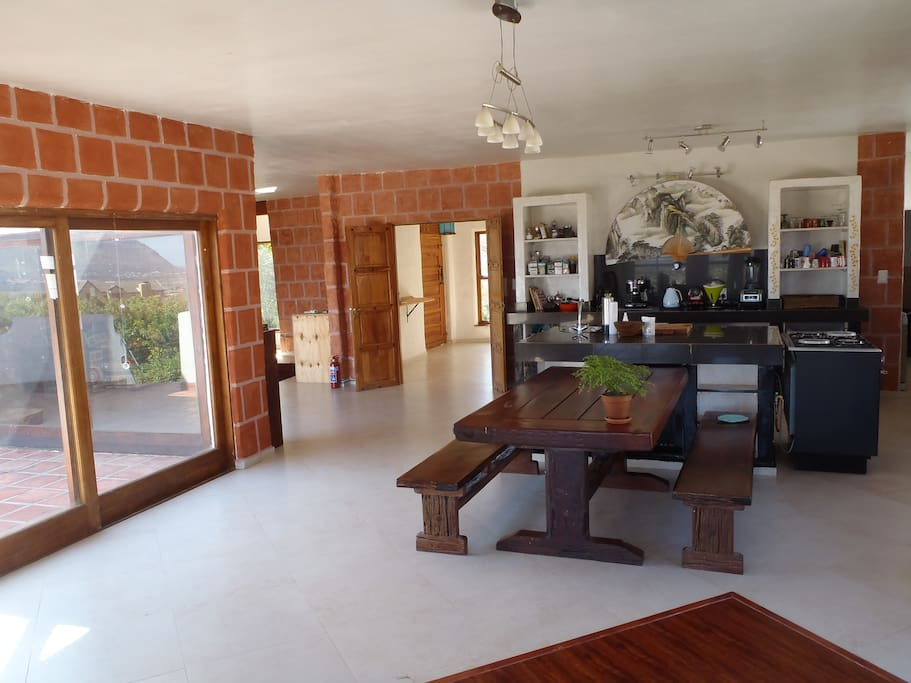 An open plan, well equipped kitchen, dining area and lounge with fireplace