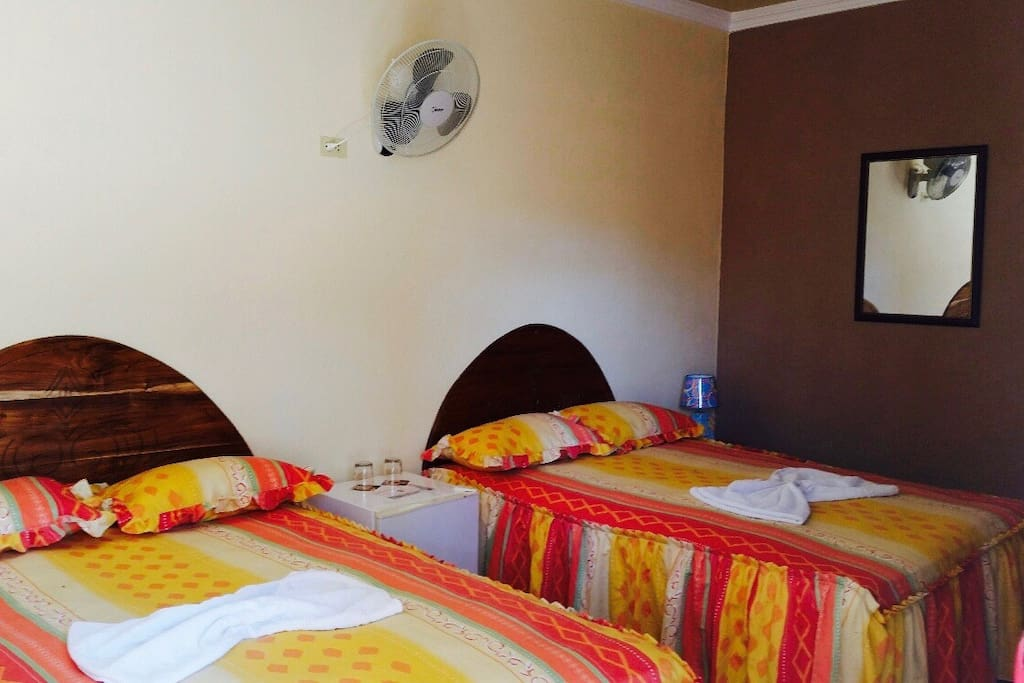 We offer double, twin and single rooms. They all come with a spacious wardrobe and bedside tables.