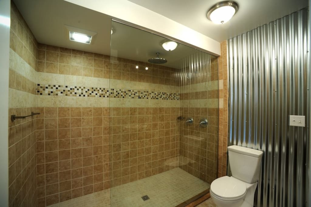 "This shower fits 8 people easily. There is a 12"" rain head and a normal shower head that will run simultaneously."