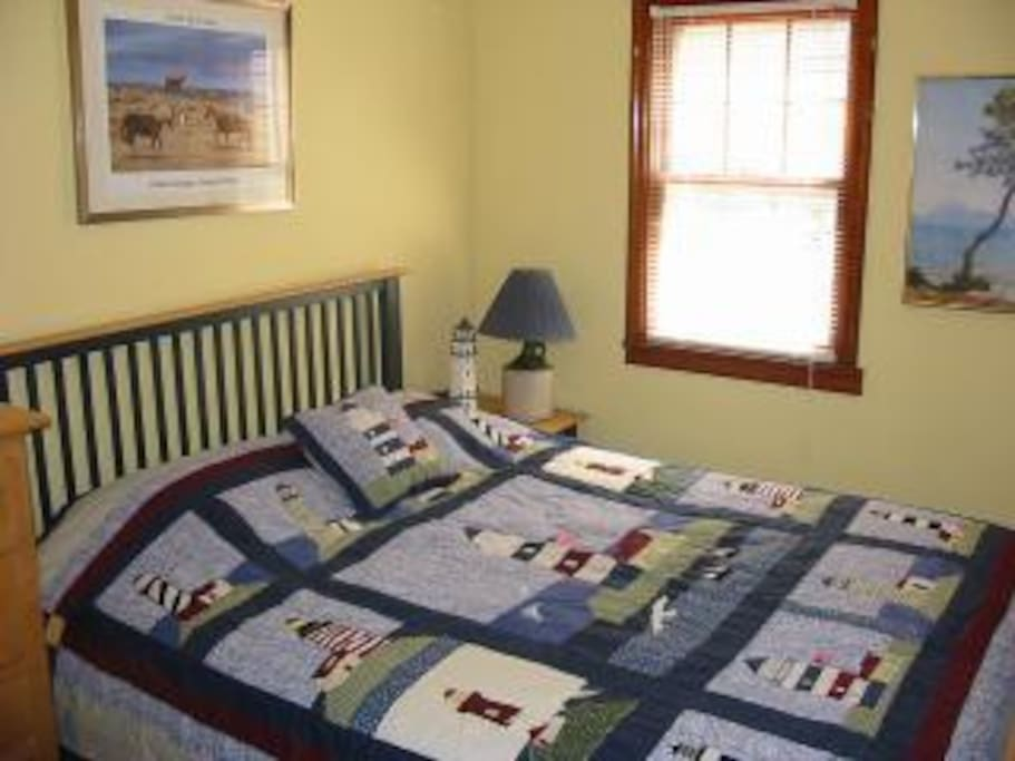 Lighthouse bedroom features a queen bed, closet, and air conditioning.