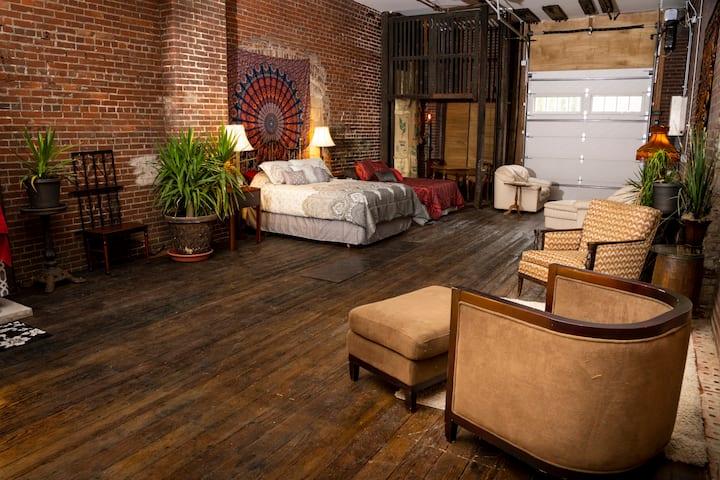 1st Fl. Bohemian Room Loft w/ garage door & patio.