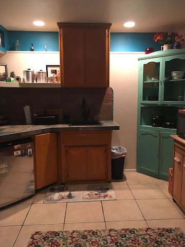 Kitchenette area, with mini fridge. You are looking at the sink, mini fridge, cupboards.