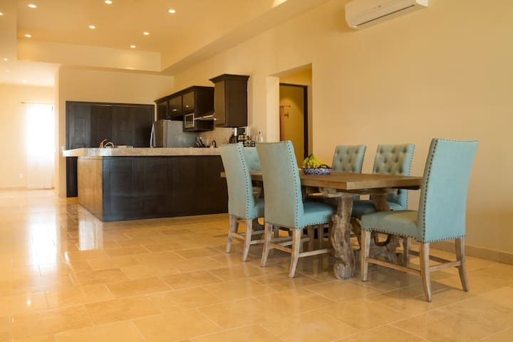 The main living space includes a large kitchen, dining table (seats 6) & living room with couch & TV.  *FREE INTERNET*