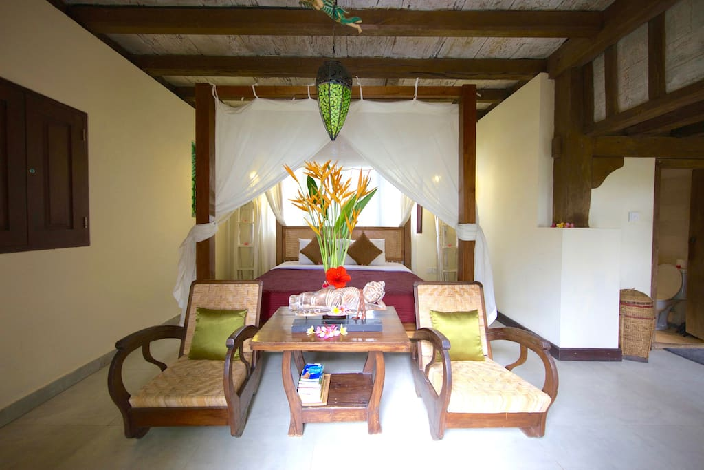 From your bed you can look straight over the rice fields through the triple fold carved teak doors