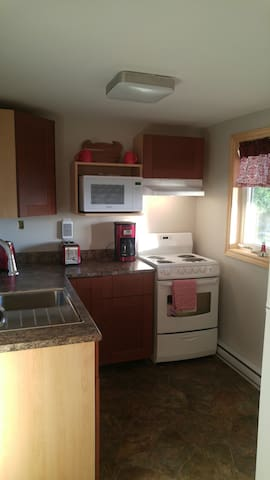Fully equipped kitchen with  fridge ,stove, water cooler , microwave, coffee