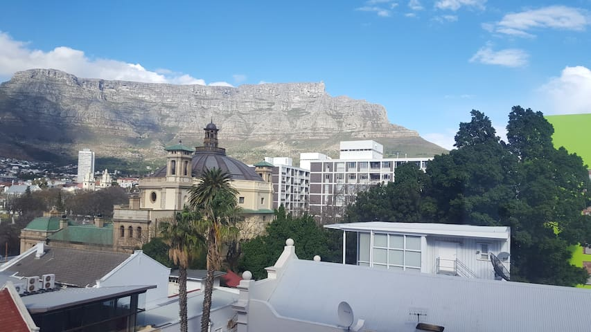 Bright, light, central. Views of Table Mountain.