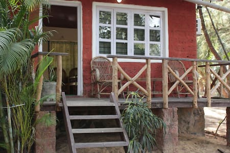 Row cottage facing both sea & lake - karwar