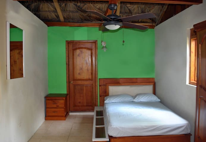Bedroom 1 with queen size bed, closet and ceiling fan (mosquito net available)