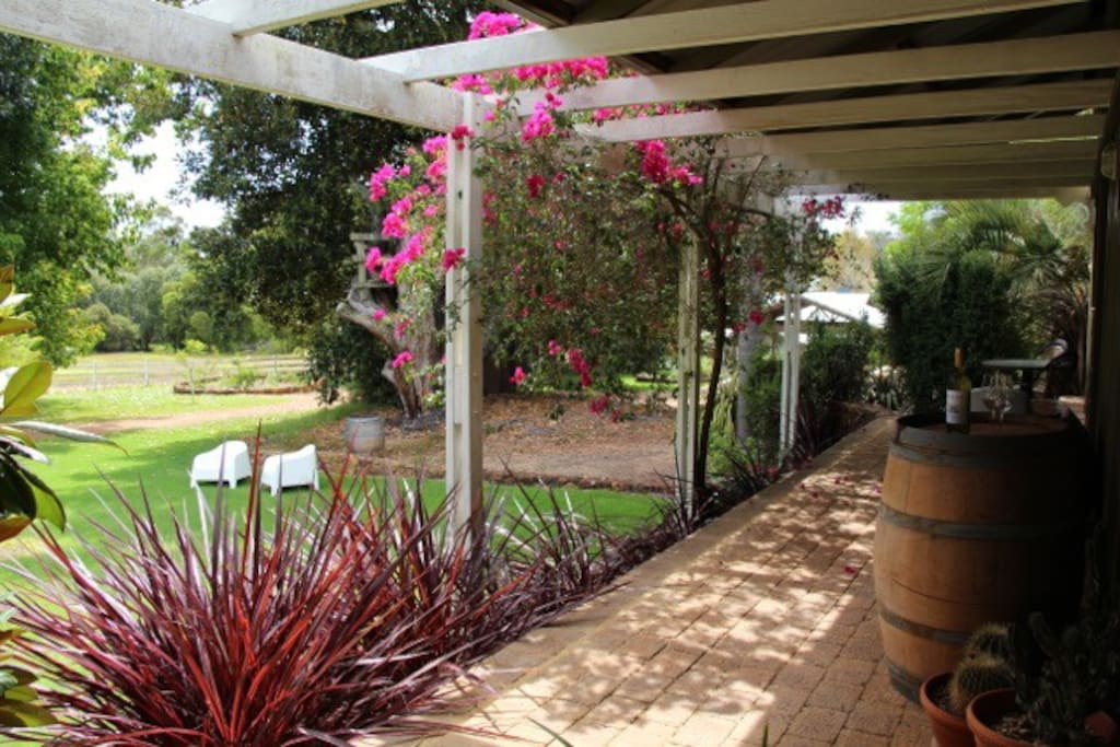Your Verandah, with table & chairs, sofa and baby Weber-Q BBA