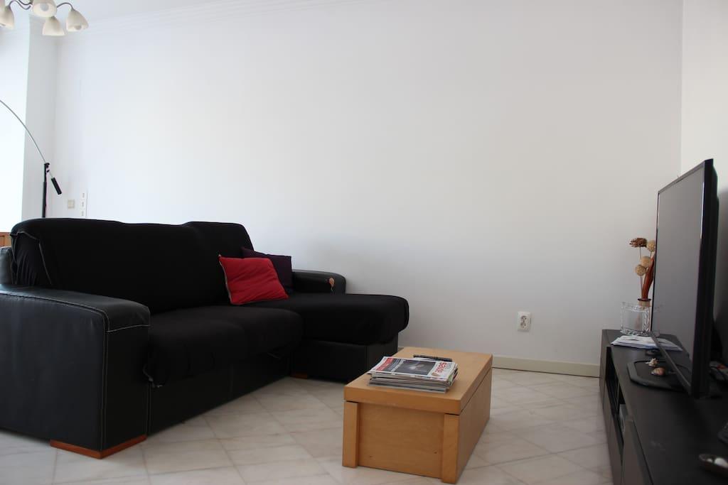 Sala sofá e tv