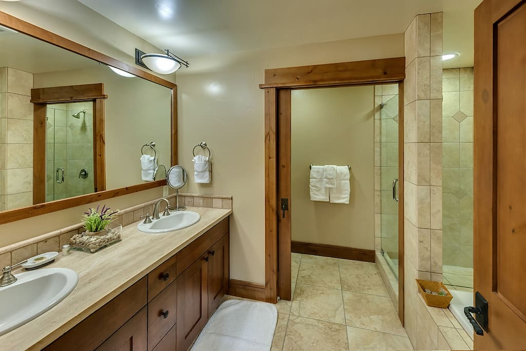 Full bathroom with dual sinks in studio