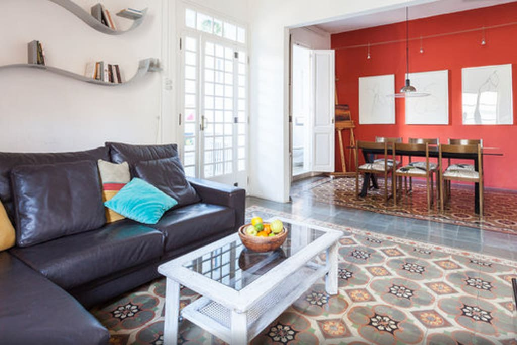 The beautiful living and dinning room with traditional catalan floors and high beam ceilings