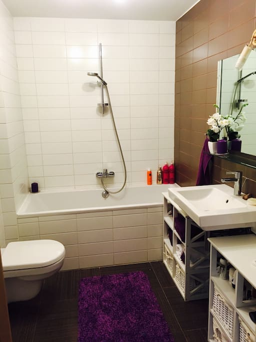 Clean and cosy SPA style bathroom with big bath and rain shower.