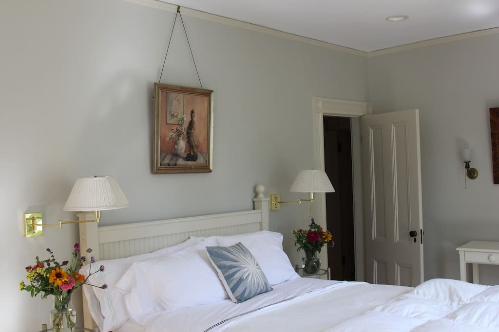 The master bedroom has four large windows with southern and eastern exposure spilling natural light into the room.  The comfortable linens, down comforter and queen mattress are new.