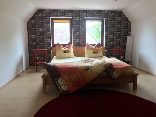 Dvoulůžkový pokoj sdílené prostory
