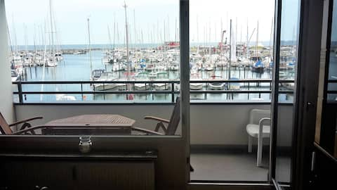 Living with views across the marina from Damp