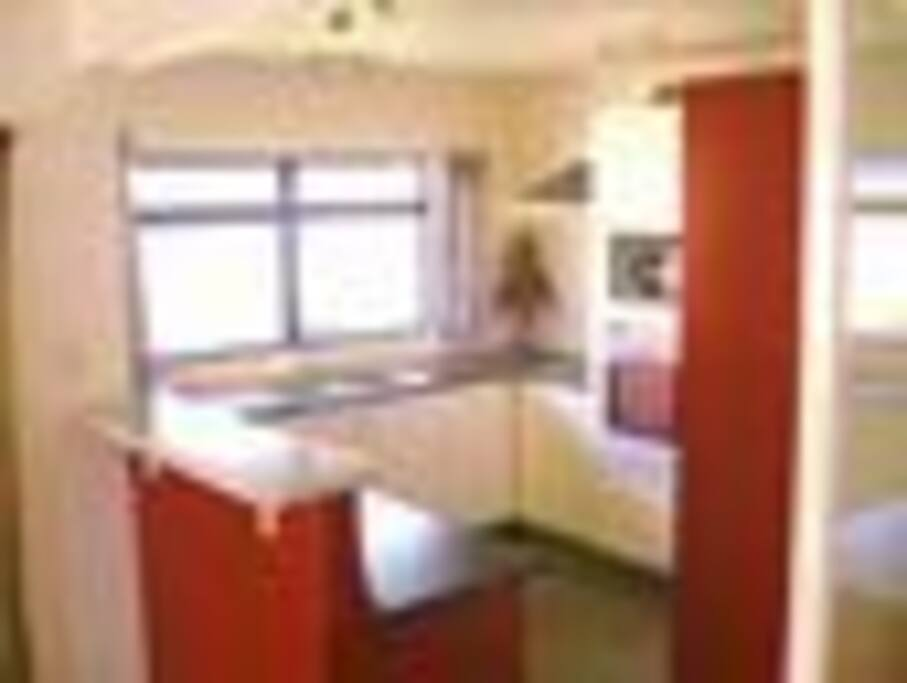 Usable kitchen, open to the dining room and dining deck