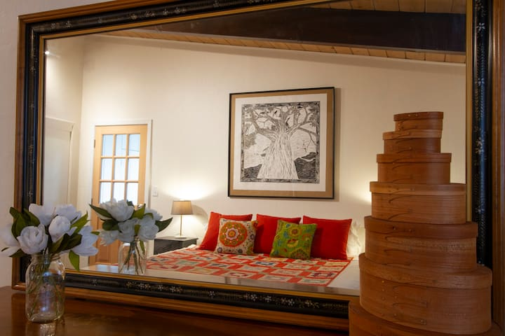The King Bed is decorated with a steam roller printed lino cut original art piece