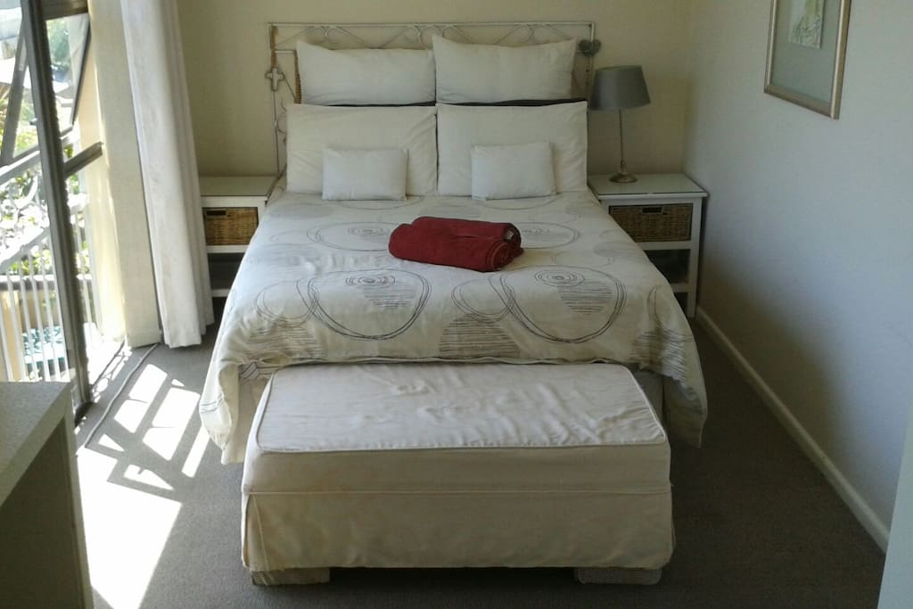 Main bedroom wit double bed and dressing room area.