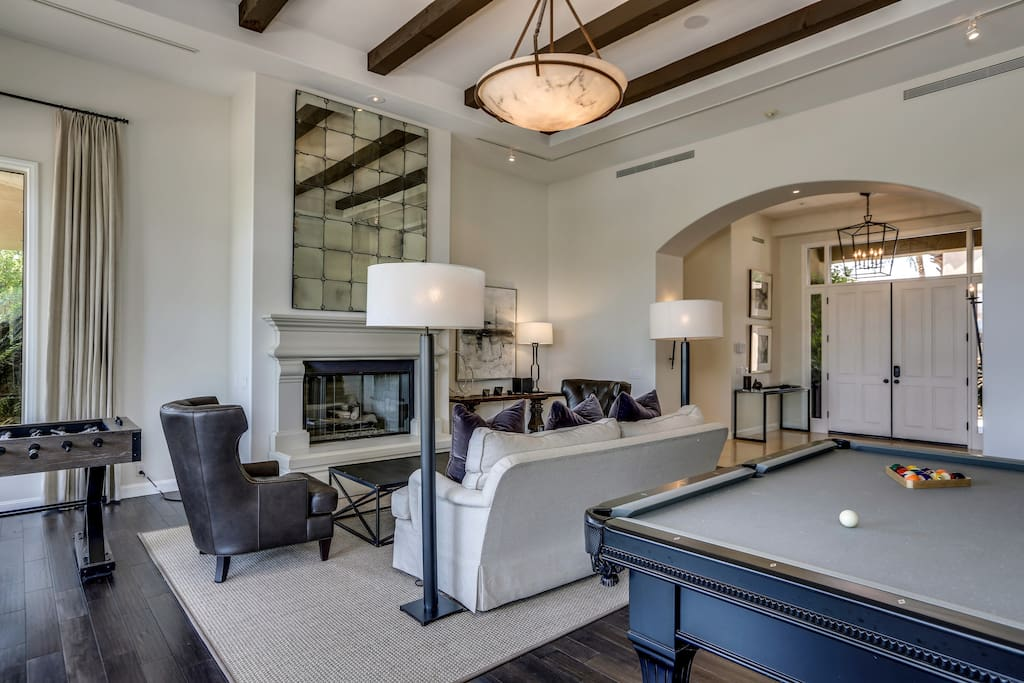 Dedicated game room with HDTV, billiards and foosball