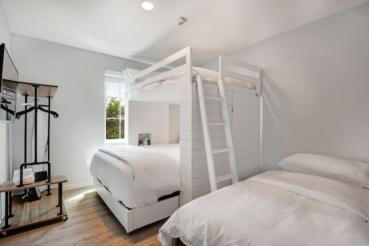 All bedrooms feature this custom-designed bunk bed with queen mattress (lower) and double mattress (upper). We can also add a single bed to up to three bedrooms in your unit as pictured here!