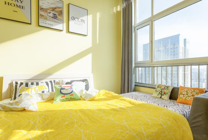 威海HOST——柠檬黄带地暖精品自助LOFT公寓 威海站韩乐坊海上公园复式南向