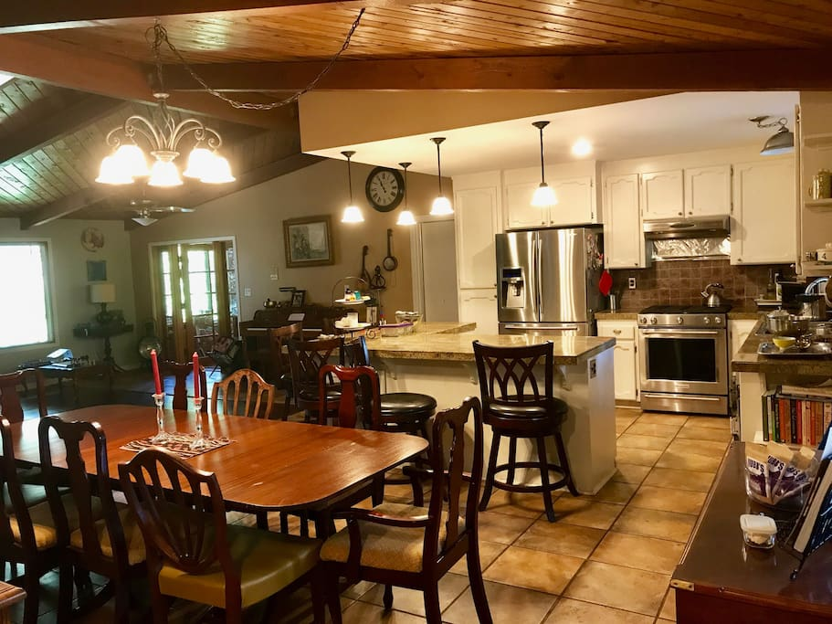 Open floor plan kitchen dining and living with open beams and lovely large picture windows
