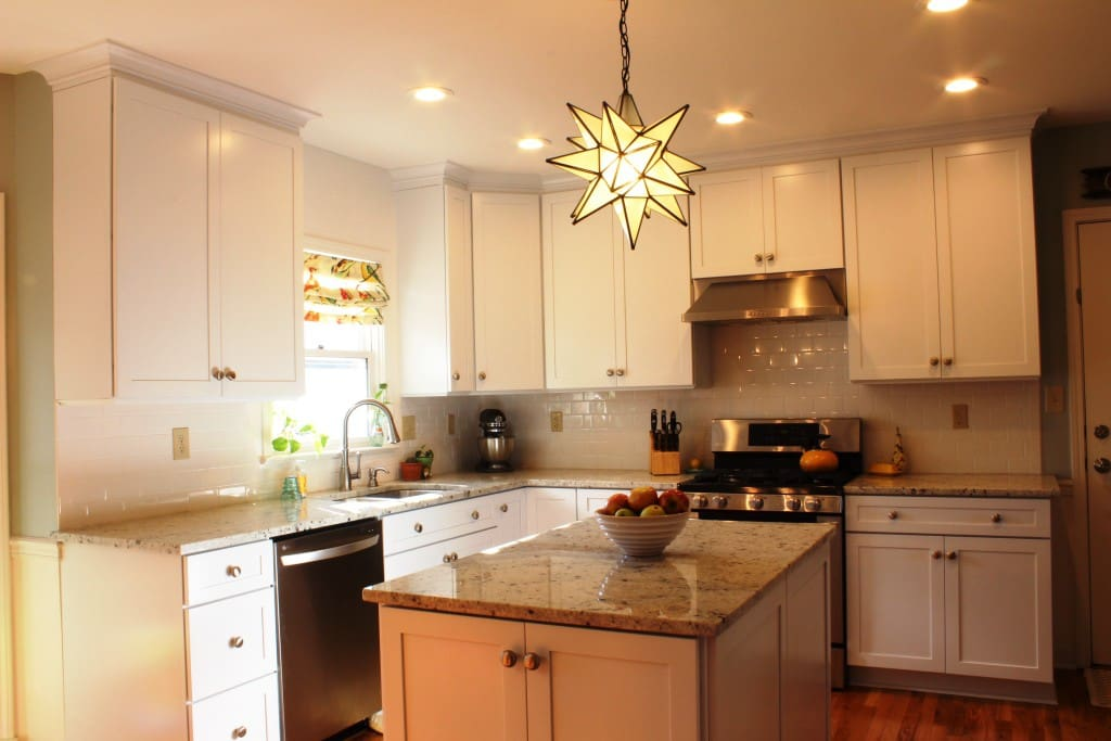 Beautiful kitchen with granite countertops and white subway tile backsplash