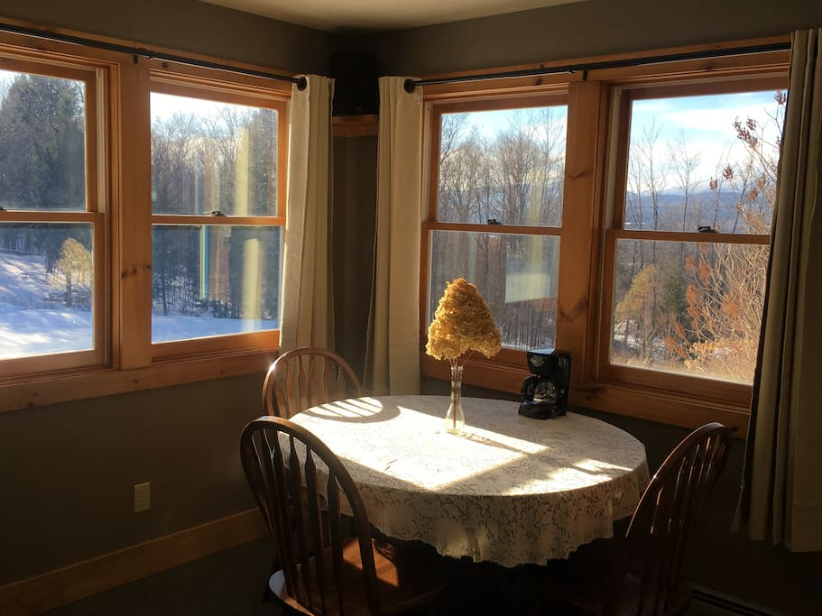 Plenty of sunlight, windows to the left look out over the pond and to the right looks out to Mt. Mansfield.