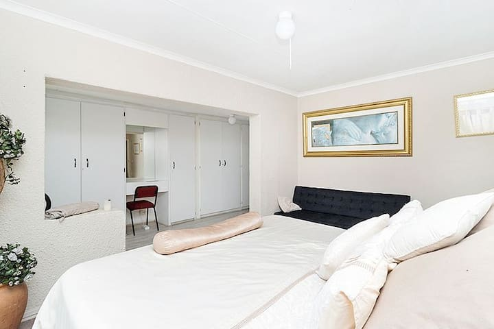 Main bedroom with King size bed and on-suite bathroom with shower. Dressing table