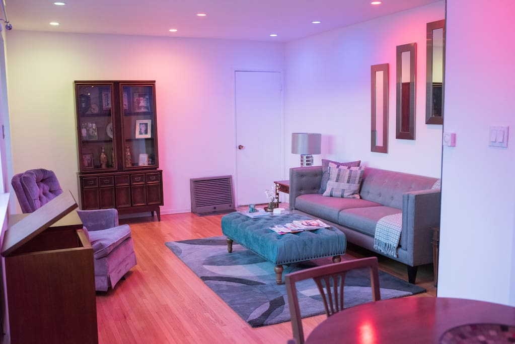Mid-Century Modern décor accentuates the Living Room and provides all the comforts of home to well-heeled vacationers