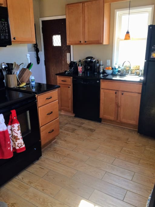 Microwave, stove, oven dishwasher, fridge, and other small kitchen appliances available for guest use.