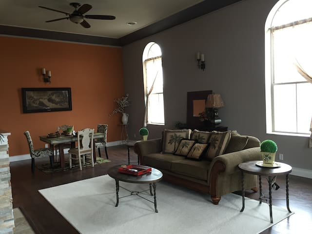 Great room Very large and open   35' by 20' with 15 foot ceilings and 10 ' high windows with great views of the Illinois river and the Abraham Lincoln Bridge