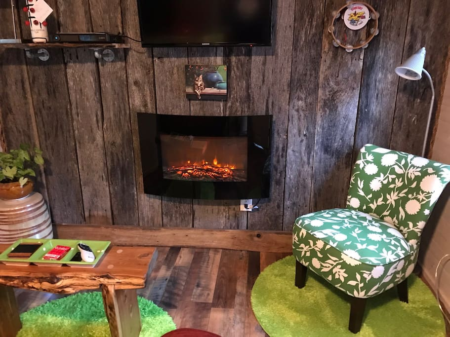 The cozy fireplace in the living area