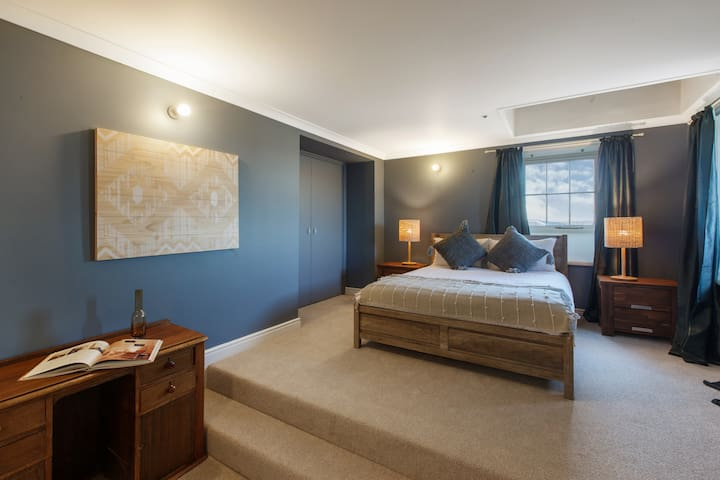 There is an additional bedroom on the first floor which comes furnished with a queen bed, plenty of cupboard space, additional seating and is well lit