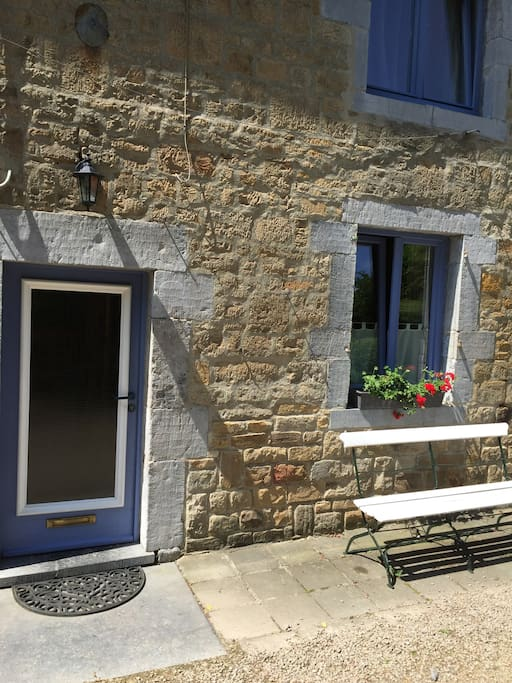 The entrance door and the bench