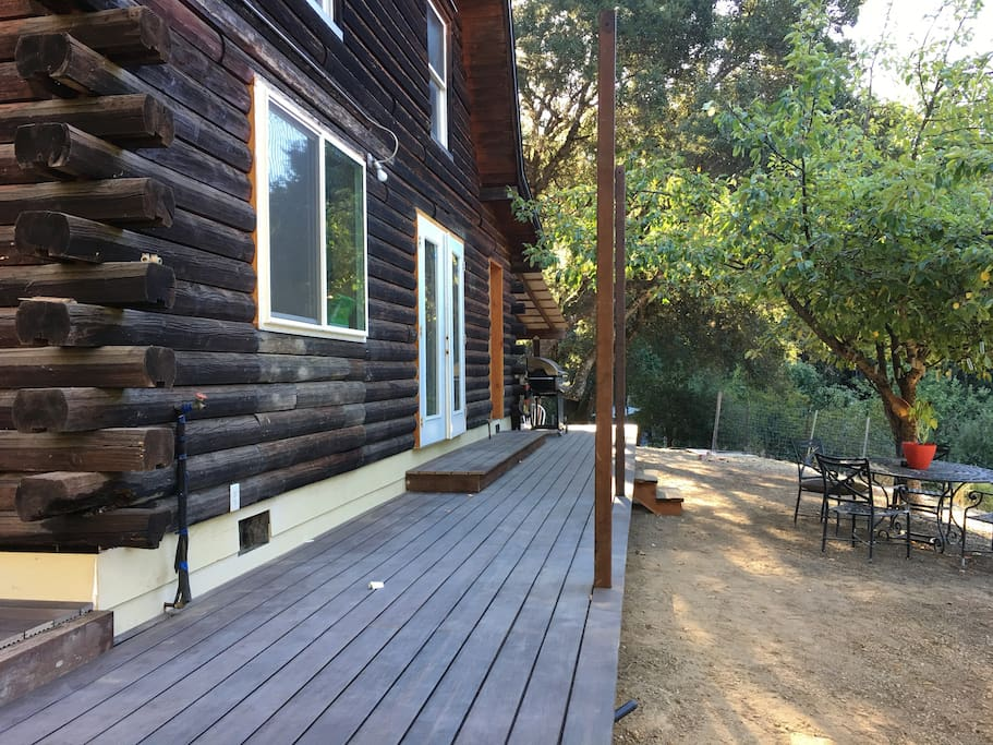 Side of cabin double doors open up to the new deck and view of our valley