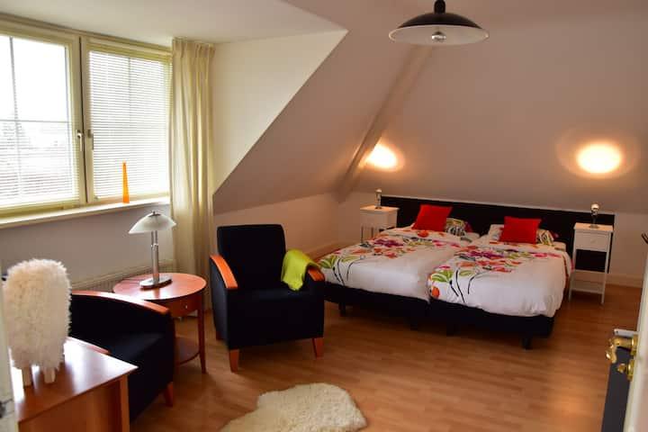 Sfeervol coronaproof appartement in luxe landhuis.