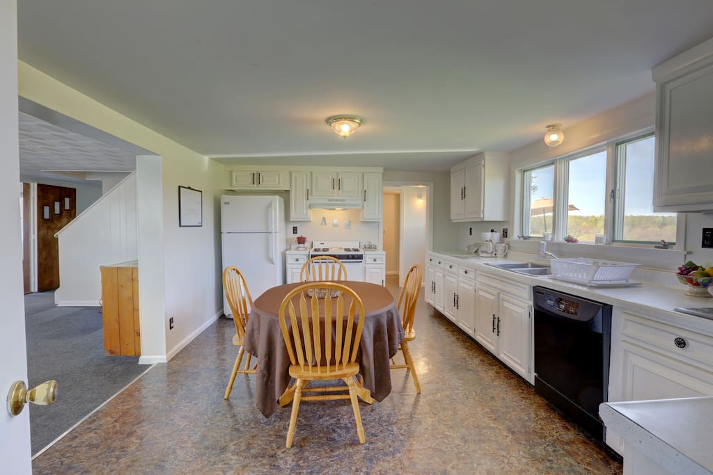 When you first enter, you will be in large kitchen with a half bath off the deck entrance.   And yes.  The dishwasher is available for use; we even provide Pods for it!